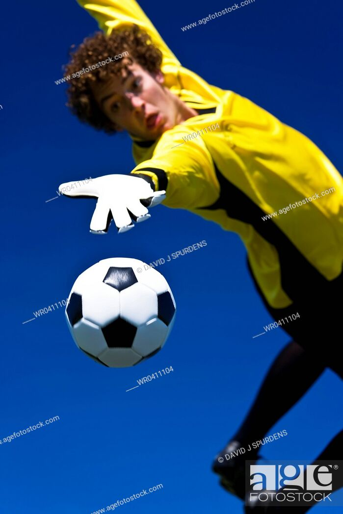 Stock Photo: The ball slips past the goalkeepers hands for a goal.