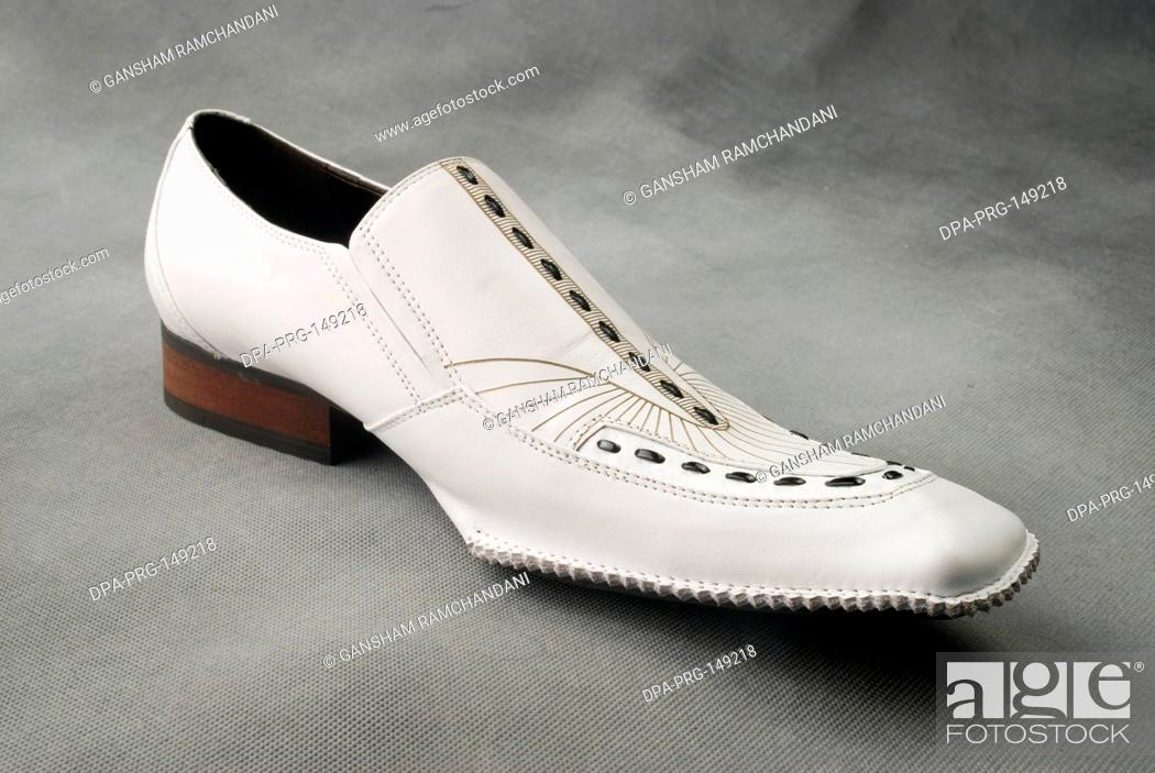 Stock Photo: White leather shoe on gray background MR.