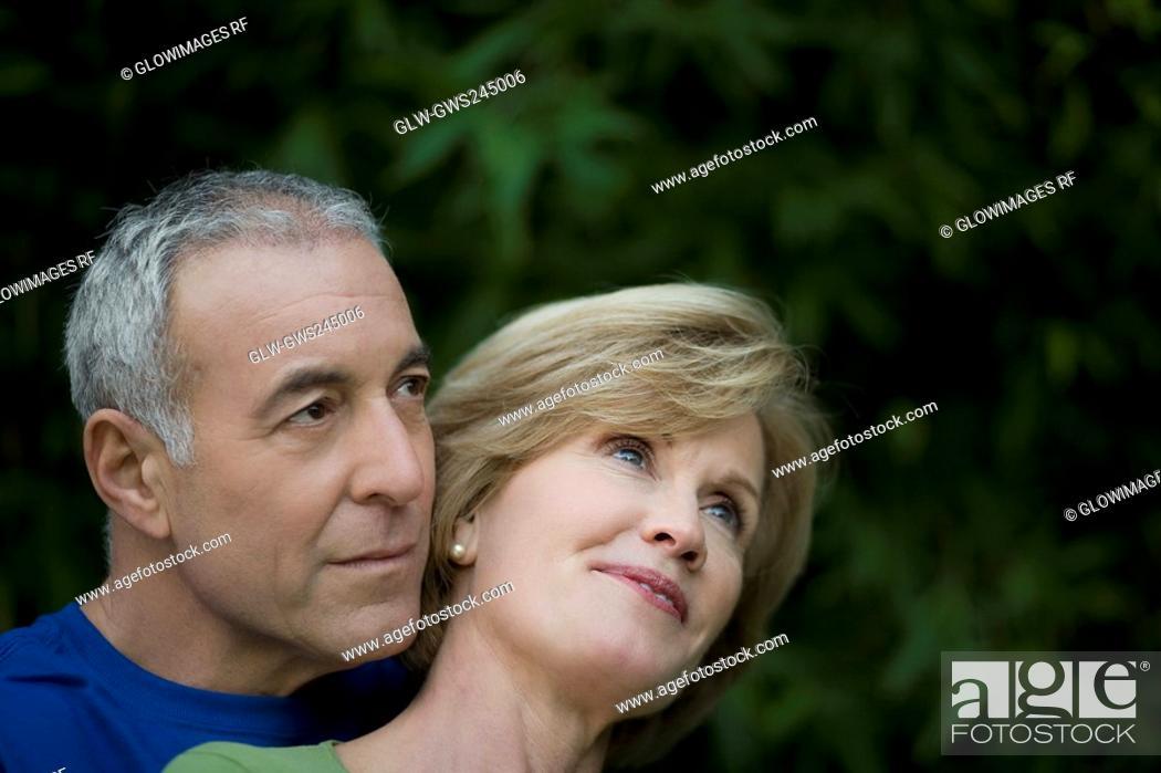 Stock Photo: Close-up of a senior man embracing a mature woman.