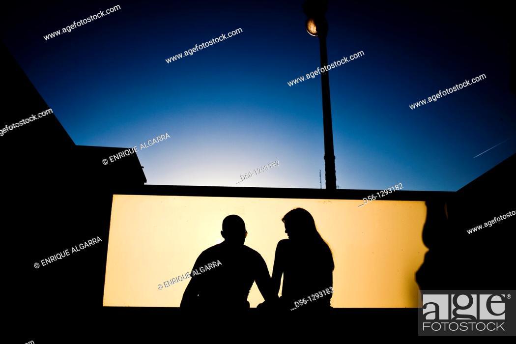 Stock Photo: couple seated at a metro station, Valencia, Spain.