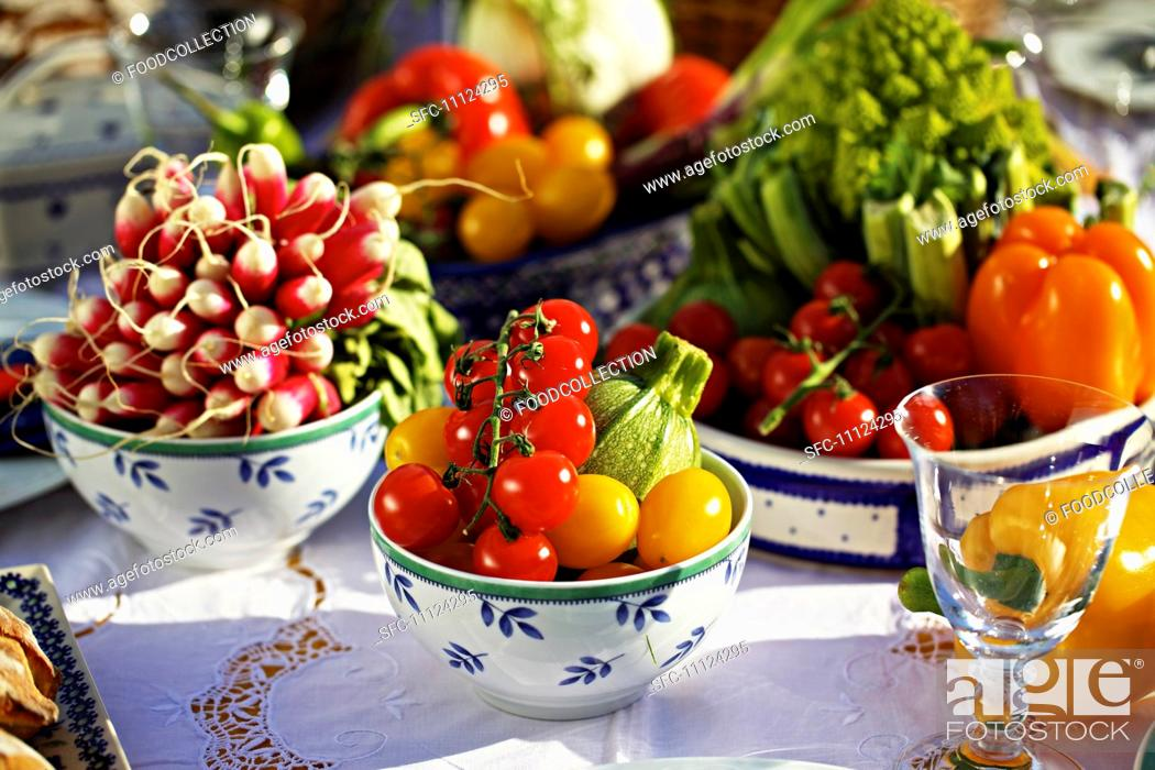 Stock Photo: Fresh summer vegetables on a table.
