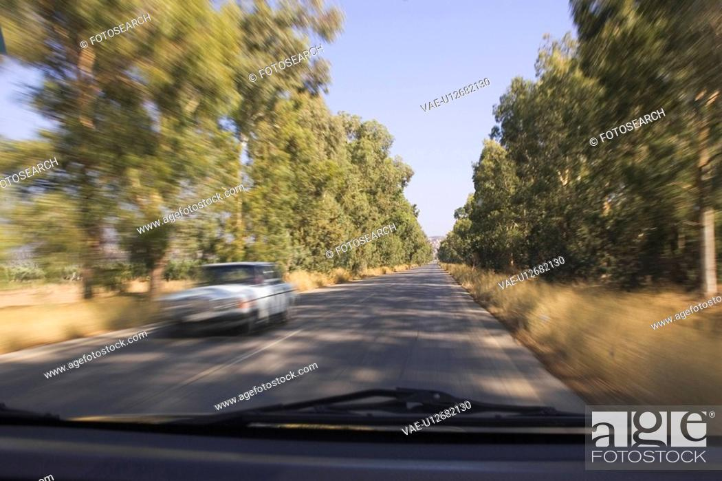 Stock Photo: Blurred Motion, Car, Clear Sky, Day.