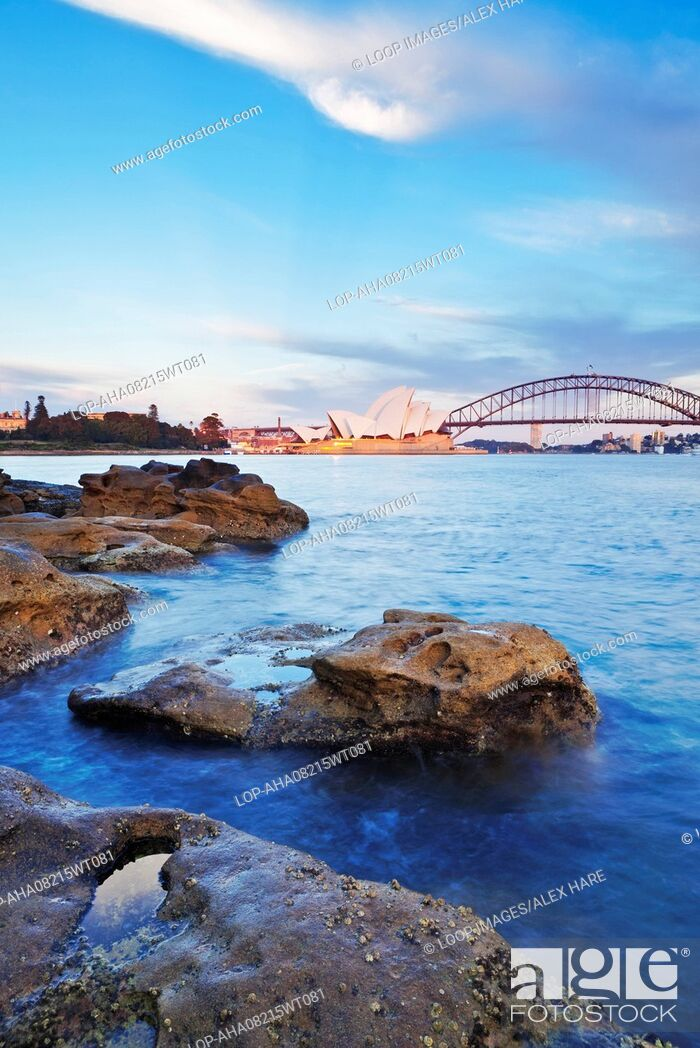 Stock Photo: A view of Sydney harbour and opera house at dawn.