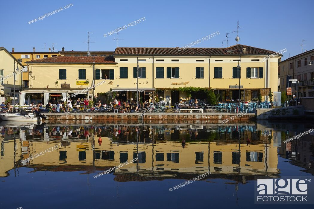 Stock Photo: Buildings along the Canal of Cervia, Italy.