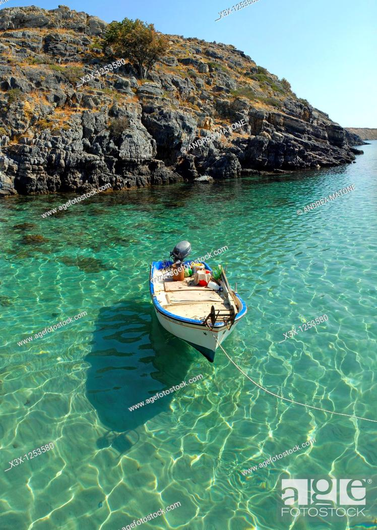 Stock Photo: A fisherman boat docked in Lindos bay Island of Rhodes Greece.