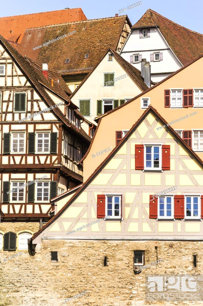 Stock Photo: historic half-timbered houses in schwaebisch hall seen from the shore of river kocher, schwaebisch hall, baden-wurttemberg, germany.