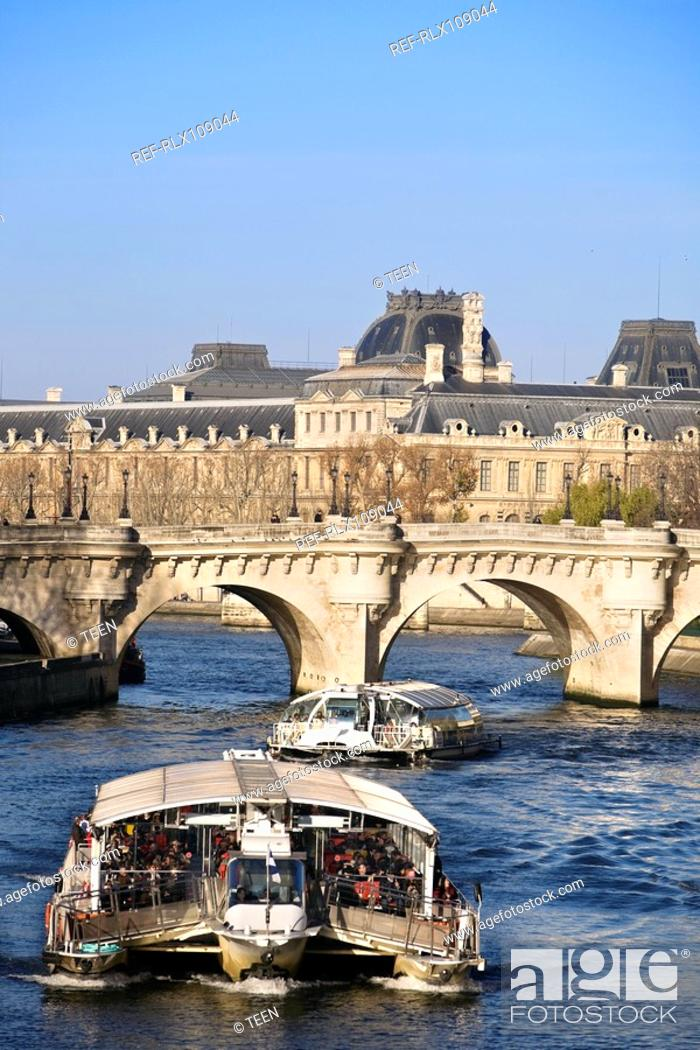 Stock Photo: Tourist boat on river Seine with Pont Neuf bridge in background, Paris, France.