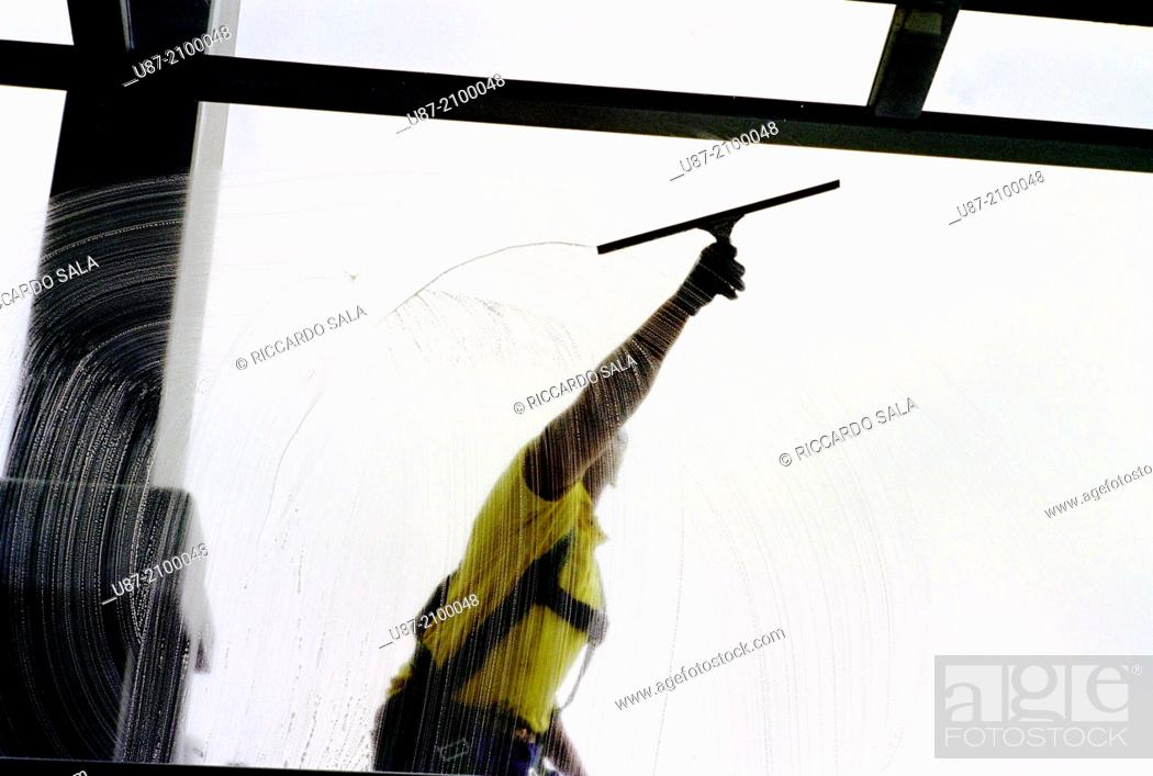 Stock Photo: Germany, Berlin, Reichstag Dome, Man Cleaning Windows of the Dome.