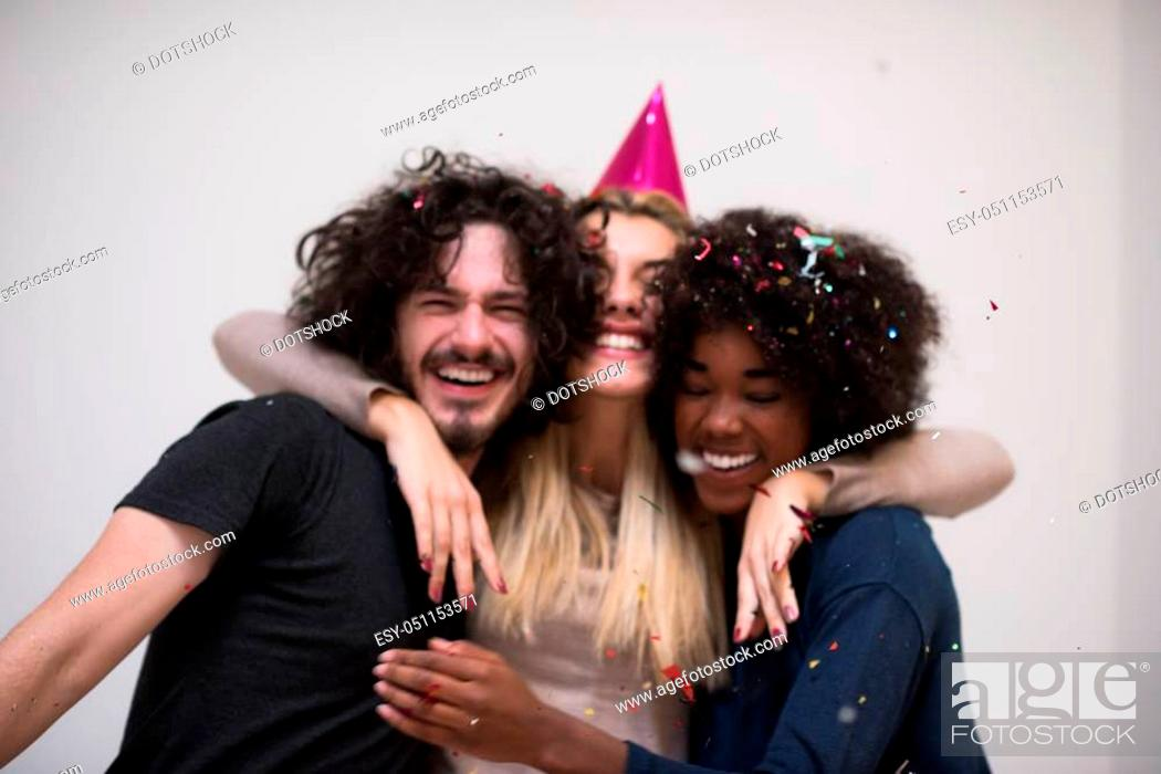 Photo de stock: confetti party Multiethnics happy young people group celebrating new year eve while dancing and have fun at home.