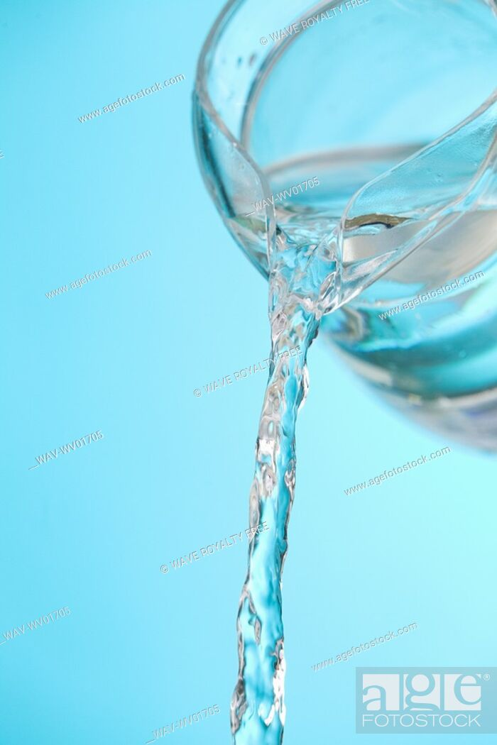 Stock Photo: Stream of water being poured from a pitcher.