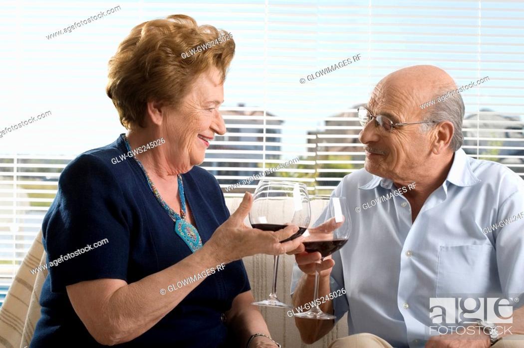 Stock Photo: Senior couple drinking wine.