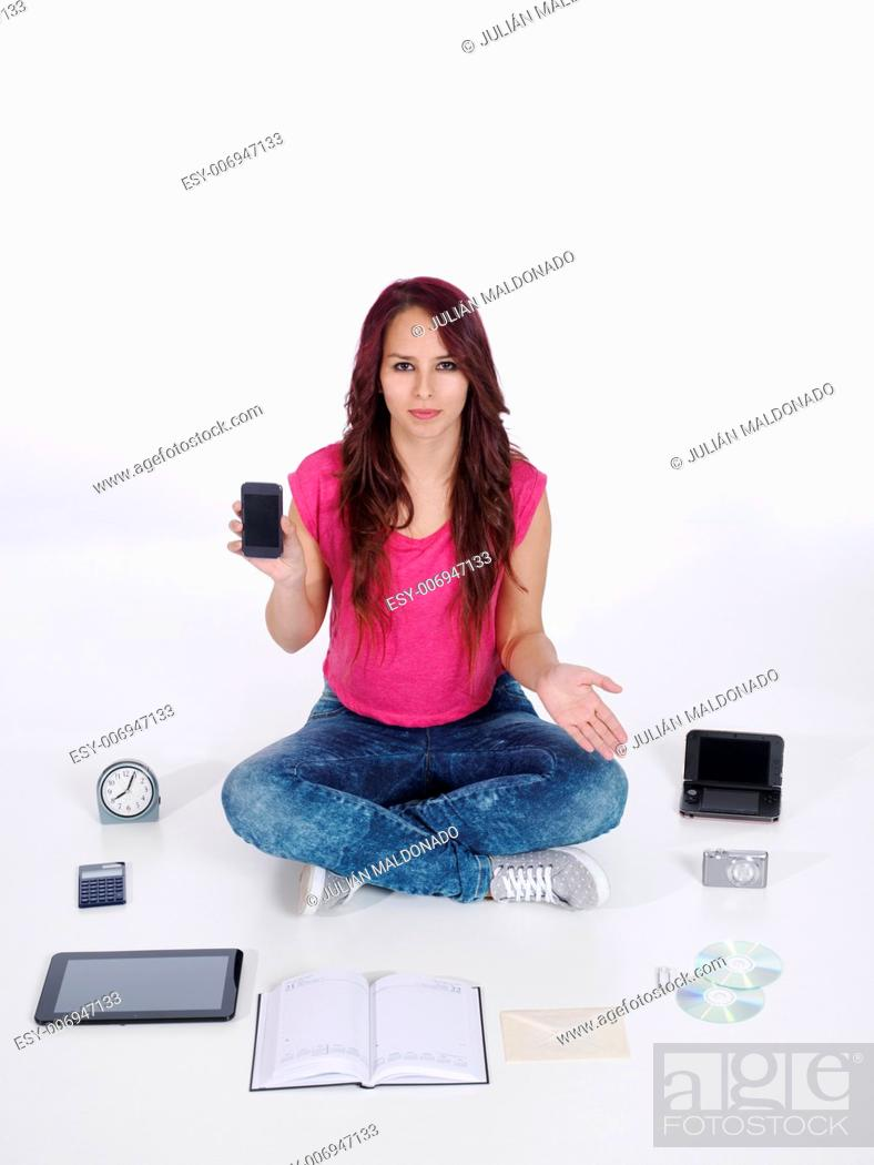 Stock Photo: Young woman with a cell phone and about all its functions.