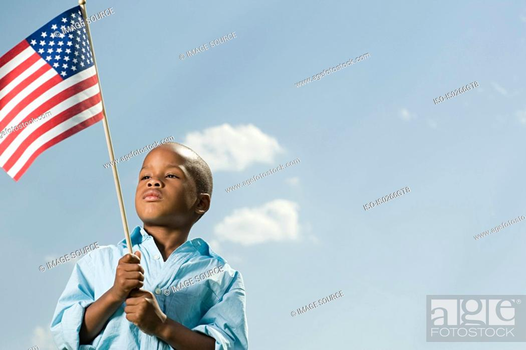 Stock Photo: Boy with an american flag.