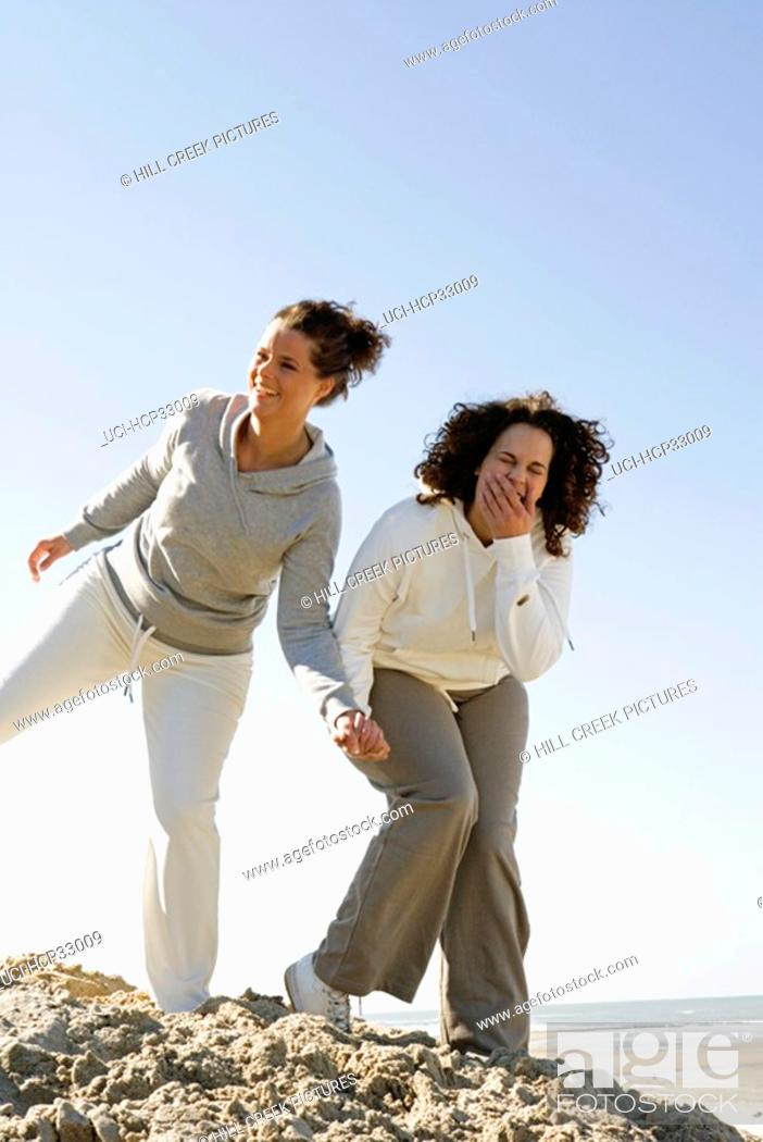 Stock Photo: Women laughing at beach.