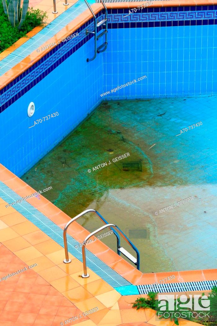 Stock Photo: Dirty hotel swimming pool. Greece.