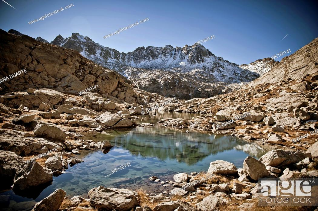 Stock Photo: Peaks of Lake at Peguera Valley, Aiguestortes National Park. Pyrenees Mountains. Lleida, Catalonia.