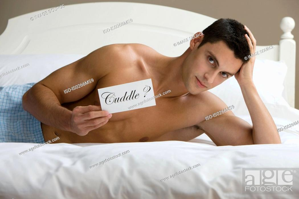 Stock Photo: A man reclining on a bed.
