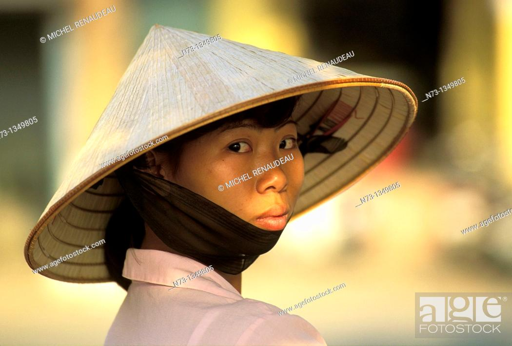 Stock Photo: Vietnam, Hanoi, young woman and her famous conical hat.
