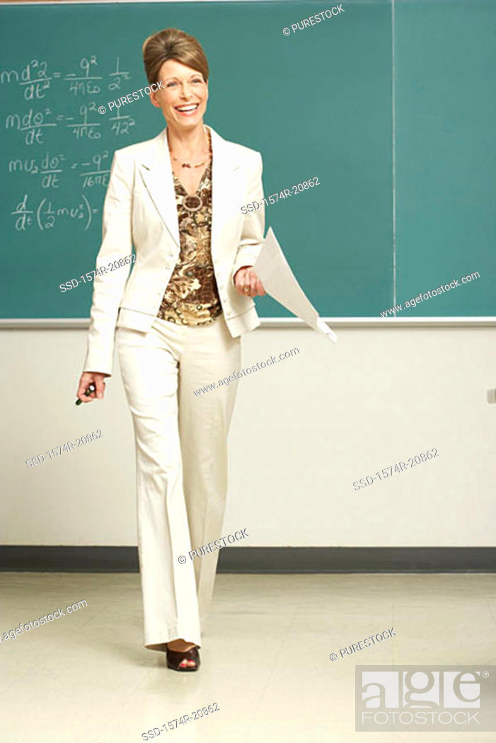 Stock Photo: Professor walking in a lecture hall and smiling.