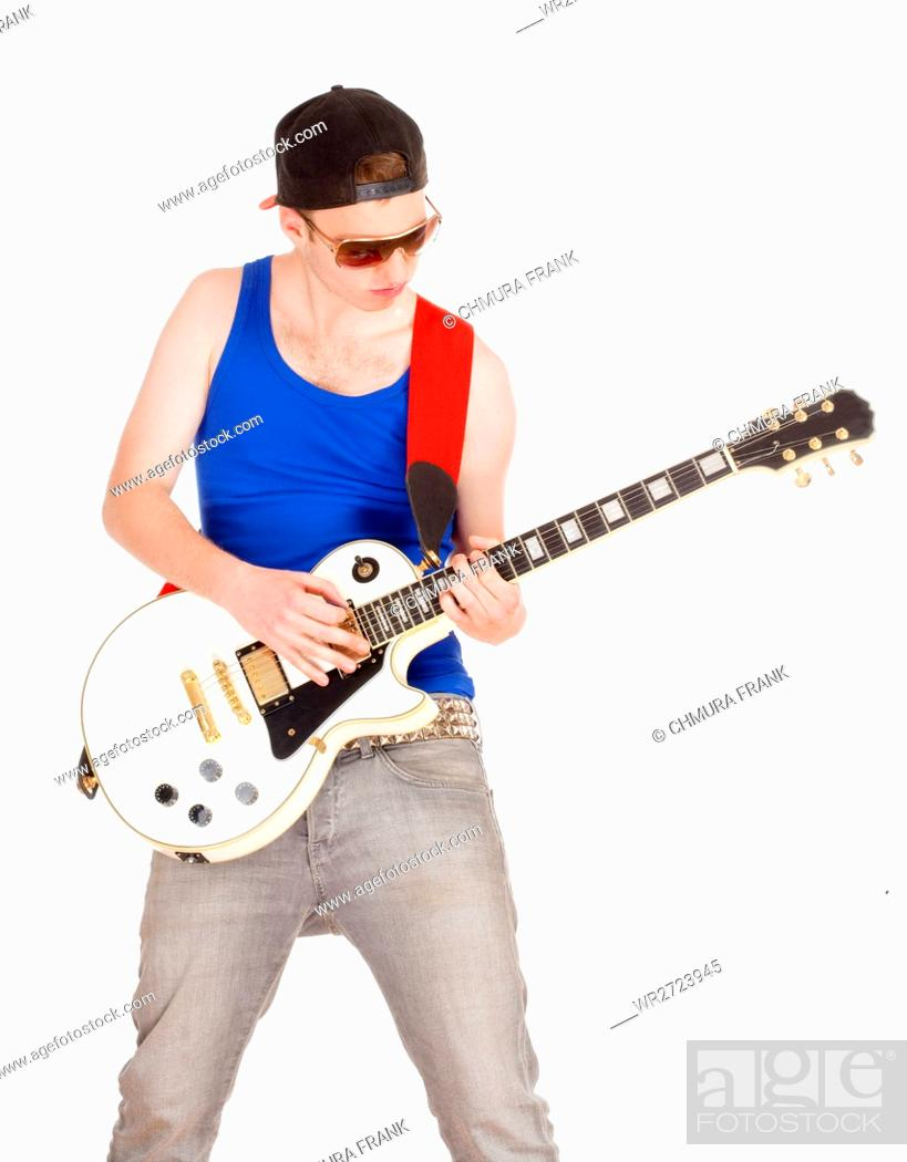 Stock Photo: Teenage Boy with Sunglasses Playing Electric Guitar - Isolated on White.