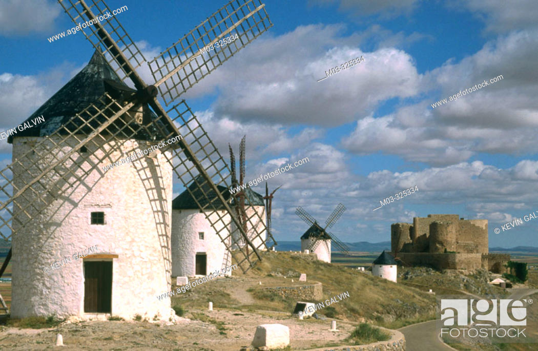 Photo de stock: Windmills with castle at backgroung in Consuegra. Toledo province. Castilla-La Mancha. Spain.