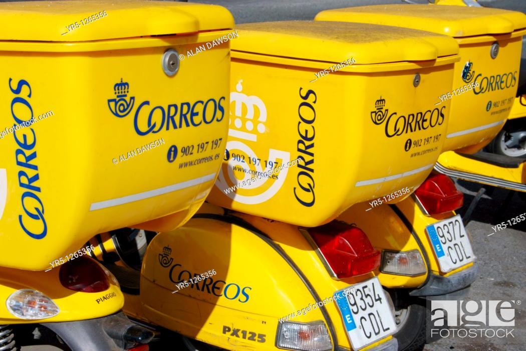Scooters used by Spanish postmen and women outside Post