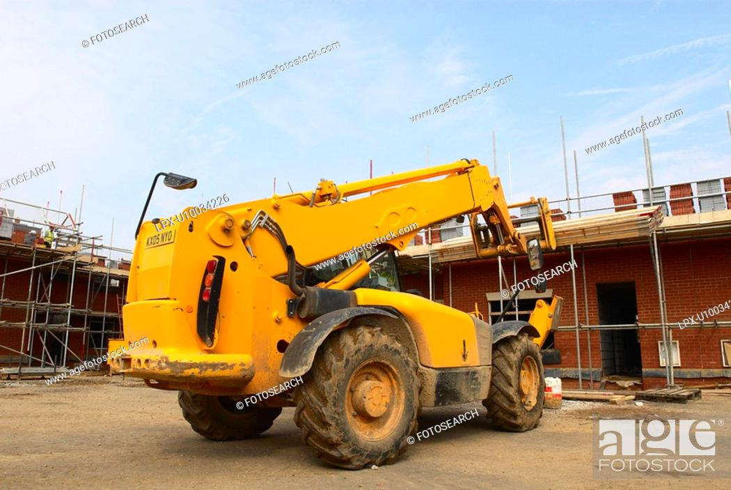 Stock Photo: Rear view of forklift on house building site.