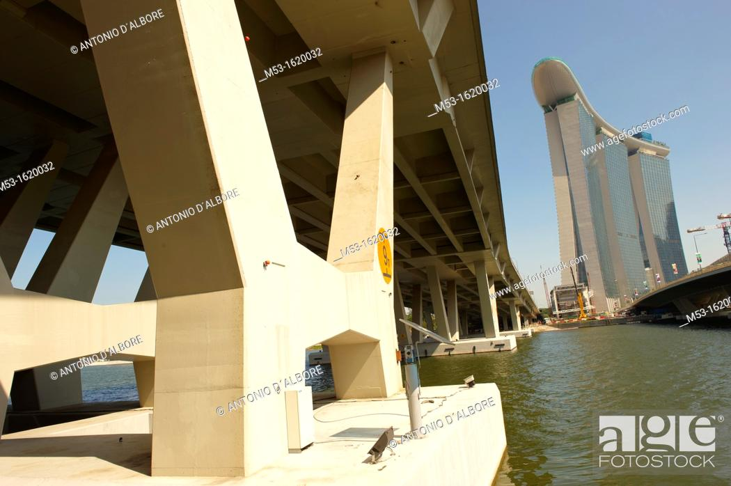 Stock Photo: Marina Bay Sands hotel seen from the reinforced concrete pylons of the Benjiamin Sheares Bridge  Singapore.