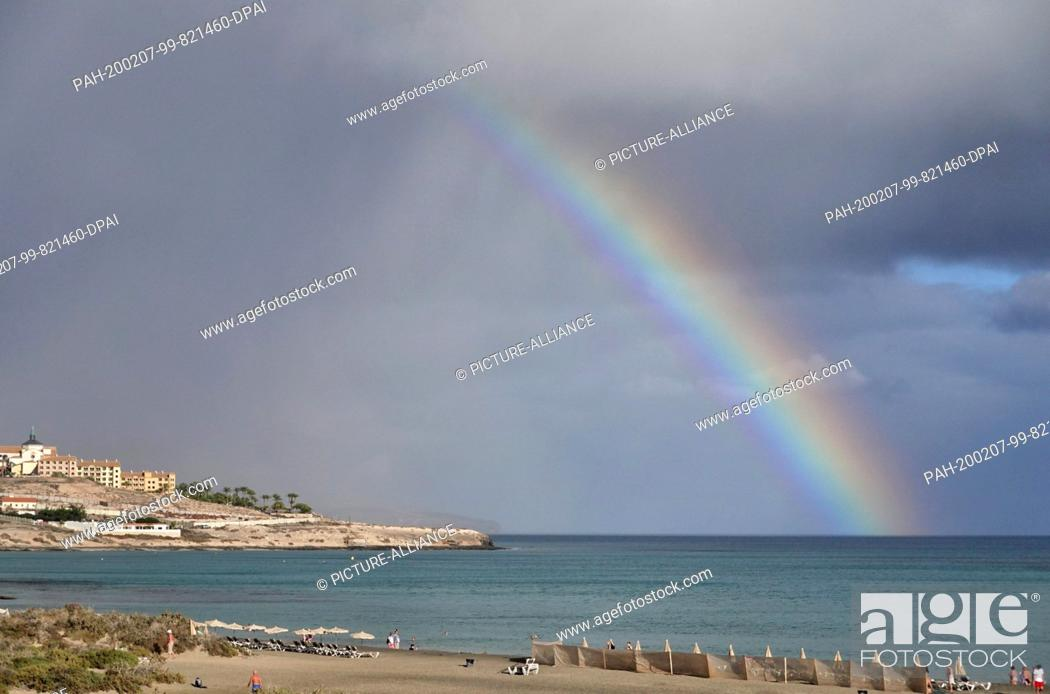 Stock Photo: 03 December 2019, Spain, Pajara: Rainbow over the Atlantic Ocean in front of Costa Calma. Photo: Soeren Stache/dpa-Zentralbild/ZB.
