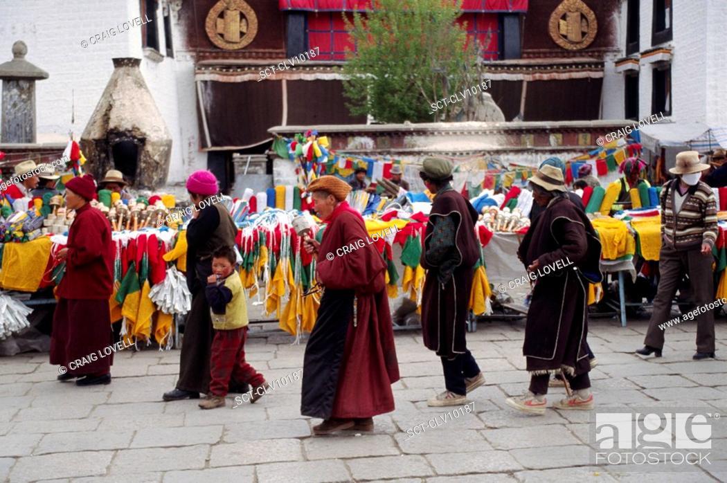Stock Photo: TIBETANS circumnambulate the Jokhang Temple along the BARKOR a TIBETAN Bazaar - LHASA, TIBET.