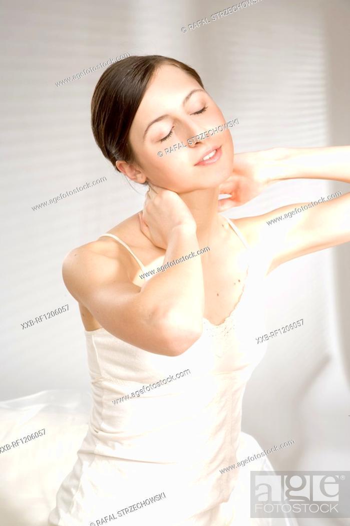 Stock Photo: young woman massaging neck.