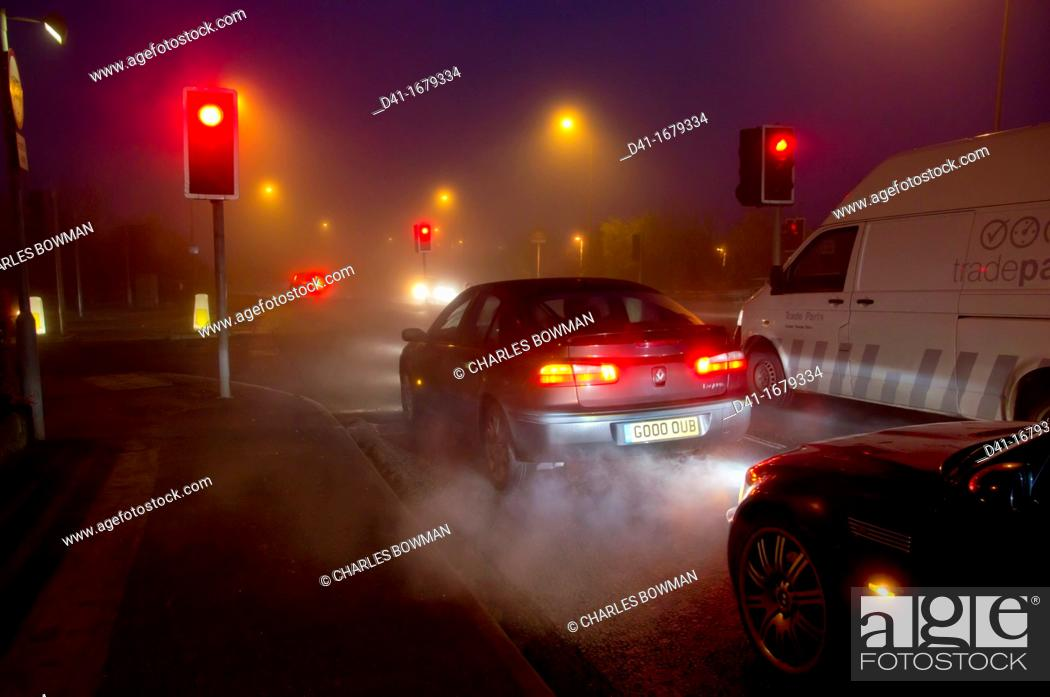 Stock Photo: Street exhaust fumes in fog.