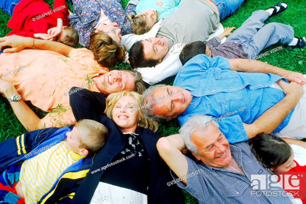 Stock Photo: High angle view of a family lying in a circle.