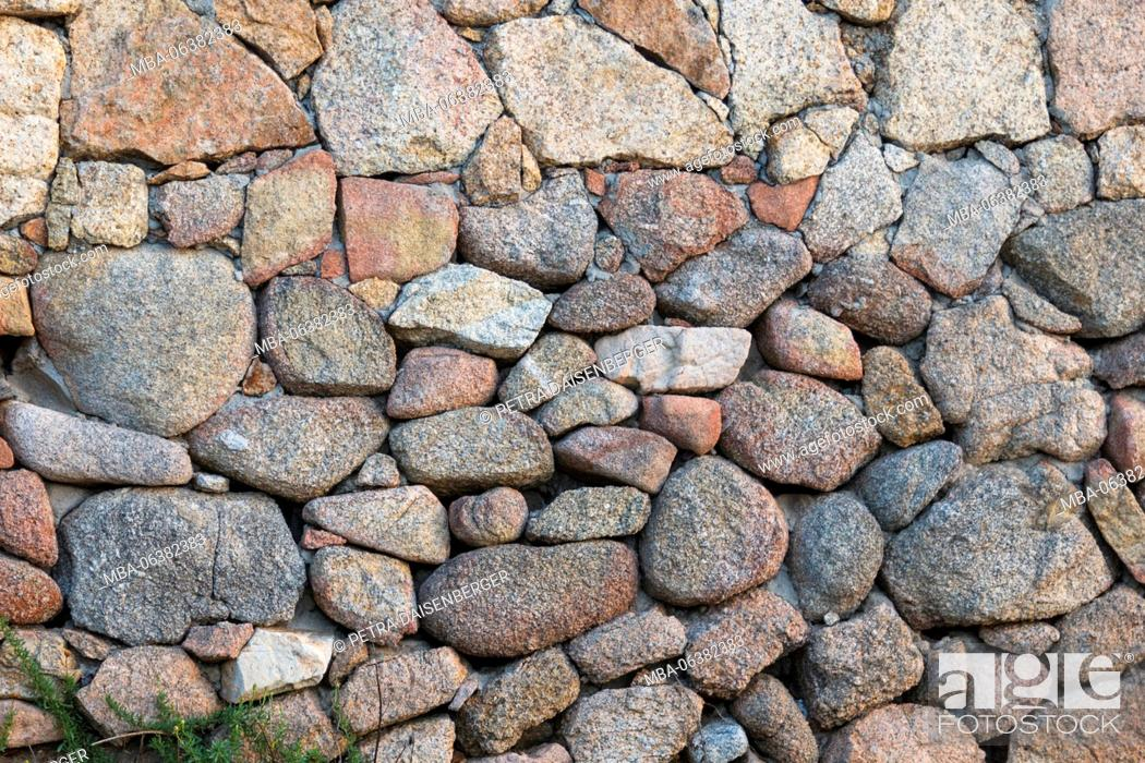 Stock Photo: Background with conception - a wall made of sliced stones,.