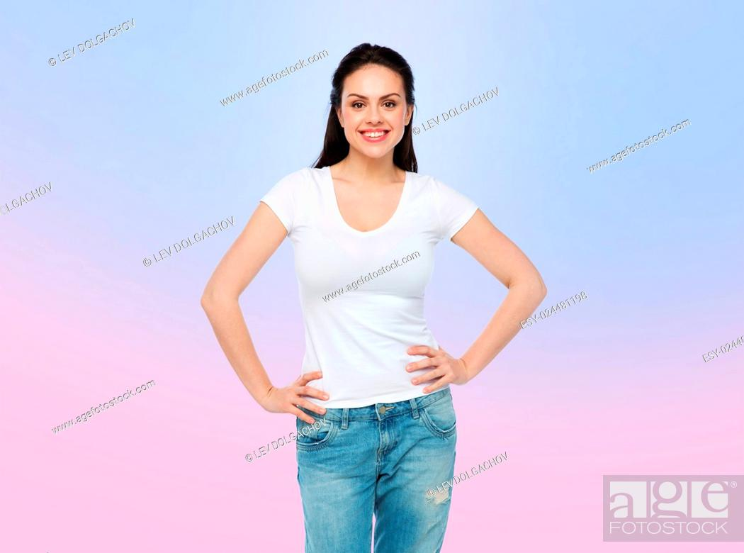 Stock Photo: advertisement, clothing and people concept - happy smiling young woman or teenage girl in white t-shirt over rose quartz and serenity gradient background.