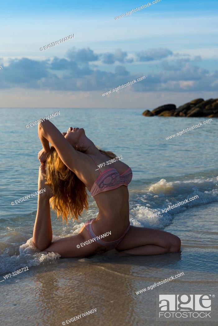 Stock Photo: Pigeon pose - beach yoga in Thailand, Koh Lipe island.