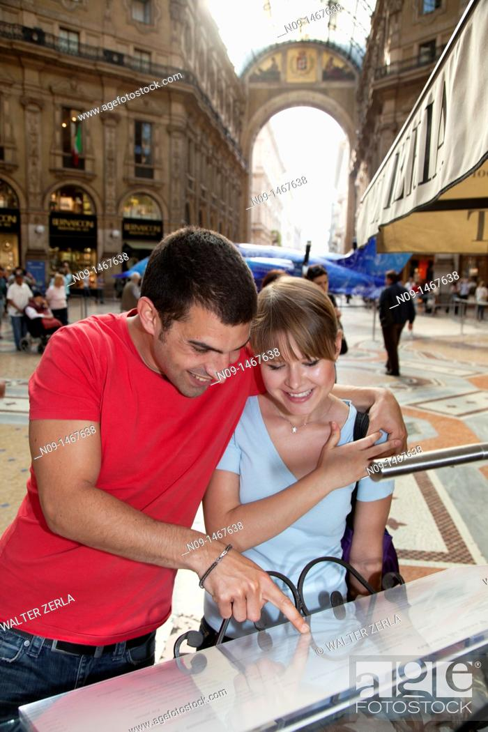 Stock Photo: Young couple in Milan, looking at menu.