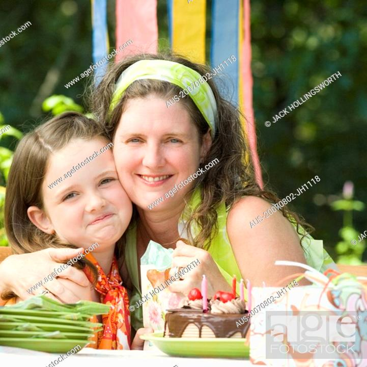 Stock Photo: Portrait of a mature woman celebrating her birthday with her daughter.
