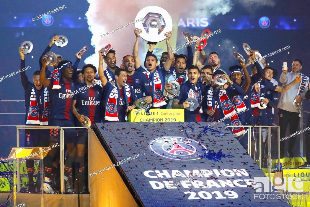 Stock Photo: Paris Saint-Germain's players celebrate with their champion's trophy at the end of the French L1 football match between Paris Saint-Germain (PSG) and Dijon at.
