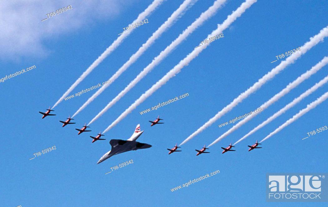 Stock Photo: Concorde and Red Arrows RAF display team, Concorde final flight over Scotland, Glasgow, 2003.