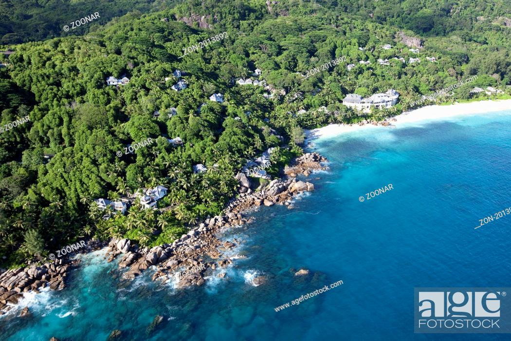Stock Photo: The Banyan Tree Hotel on the beach Anse Intendance.