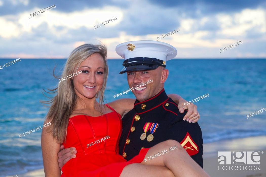 Stock Photo: Marine and his lady getting engaged on the beach; Kailua, Island of Hawaii, Hawaii, United States of America.