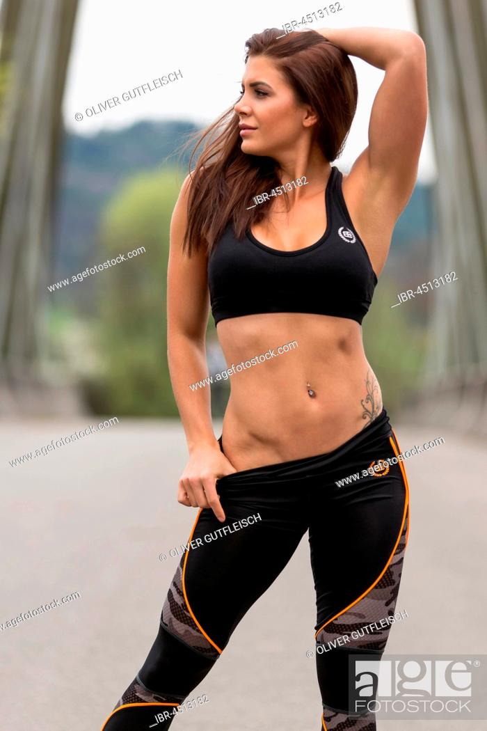 Photo de stock: Young woman in sporty outfit.