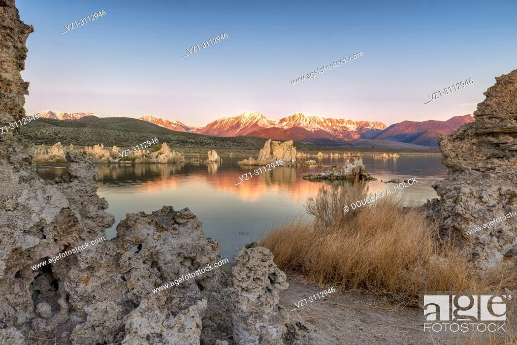 Stock Photo: Above Mono Lake Tufa alpenglow on the Sierra Nevada Mountains display a vivid orange-red, reflecting the momentary spectacle the lake's edge, Lee Vining, CA.