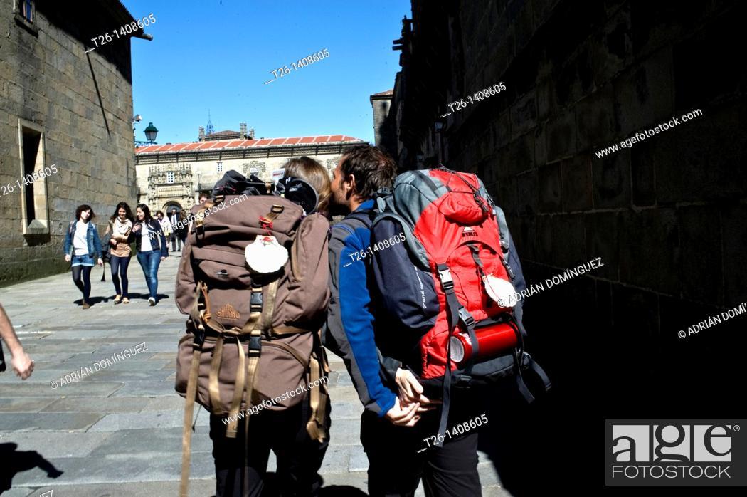 Stock Photo: Couple arrive to Santiago de Compostela. Galicia, Spain.