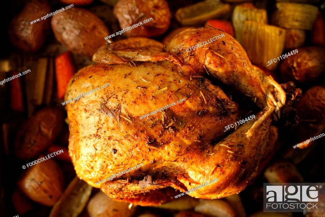 Stock Photo: Whole Roasted Free Range Chicken with Herbs in a Pan with Organic Vegetables.