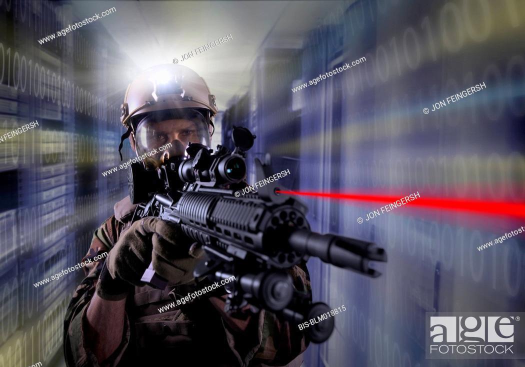 Imagen: Soldier holding gun in server room.