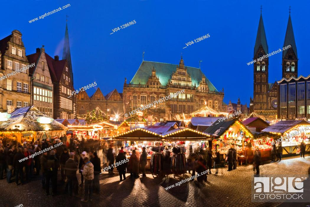 Stock Photo: View over the christmas market at dusk. Town hall and cathedral in background. Marktplatz. Bremen, Germany.