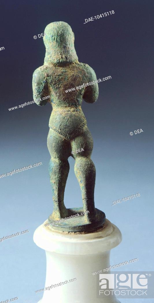 Stock Photo: Bronze statue depicting armed figure making offering, rear view. Etruscan Civilization, 625-600 BC.  Arezzo, Museo Archeologico Statale Nazionale 'Gaio Cilnio.
