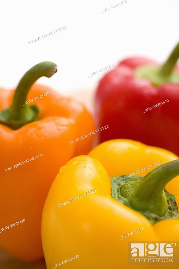 Stock Photo: Close-up of yellow, orange and red peppers.